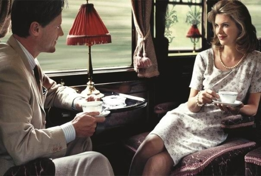 Он вошёл в вагон, и увидел её, одиноко сидящую у окна…