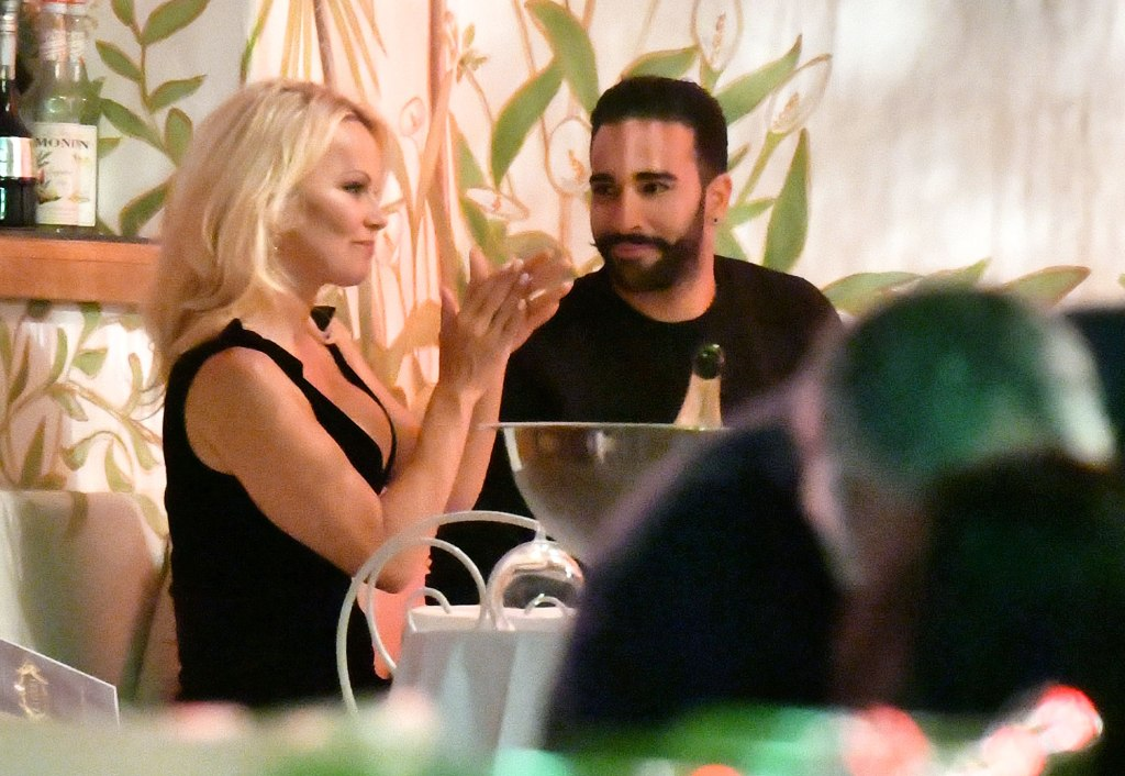 Pamela Anderson and her boyfriend Adil Ramy enjoyed a romantic dinner with champagne in the VIP section of La Gioa restaurant in St. Tropez.